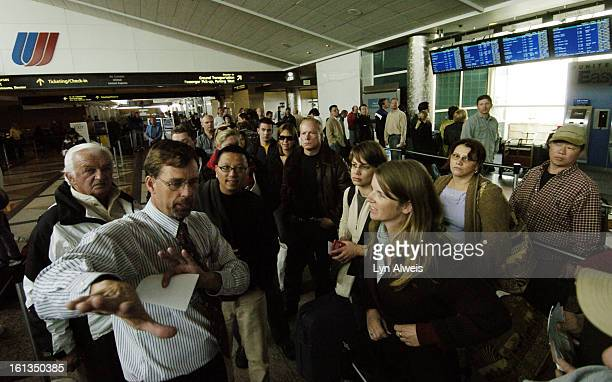 An April snowstorm strands many at Denver International Airport United Airline employee Everett Sisson Service Director helps a long line of...