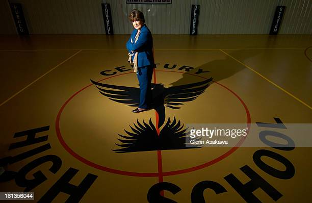 PUEBLO COLORADO SEPTEMBER 27 2005Cherrie <cq> Greco <cq> warden of the Youth Offender System in Pueblo stands by the Phoenix logo on the gym floor of...