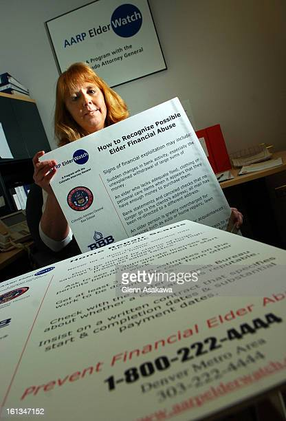 DENVER COLORADOJANUARY 19 2005Janice <cq> Friddle <cq> director of AARP ElderWatch program holds up posters her office keeps to educate potential...