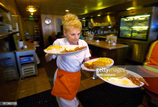 DENVER COLORADOMARCH 2 2006Server Roxanne Stacey <cq> races down with an armful of plates at the Breakfast King restaurant at 300 W Mississippi Ave