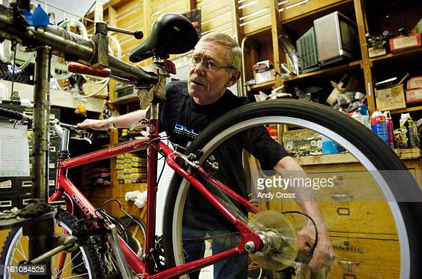 DENVER COAPRIL 5TH 2006Third generation bike shop owner <cq> Tito Collins <cq> Collins Bicycles <cq> on 3217 E Colfax works on a bike overhaul in his...