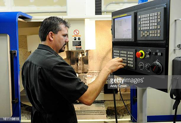 AURORA COMAY 13TH 2009Derek Sheahan Platinum Precision Machining in Aurora works a Vertical Machining Center VMC at his shop Wednesday morning THE...