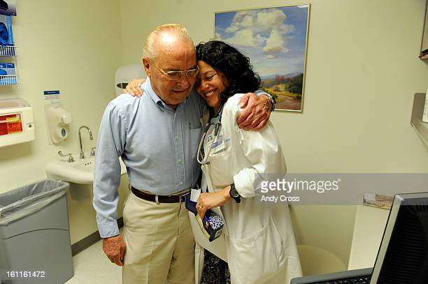 LAFAYETTE COSEPTEMBER 1ST 2009Longtime Kaiser patient Ben Barr 76yearsold right hugs his doctor DeeAnn Rivera MD after giving her a bag of chocolates...