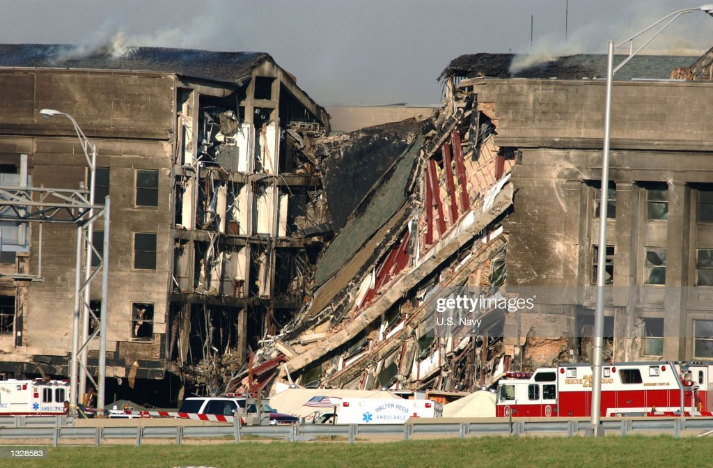 A 200-foot gash exposes interior sections of the Pentagon following a suspected terrorist crash of a hijacked commercial airliner into the Pentagon September 11, 2001 in Arlington, VA. The attack came at approximately 9:40 a.m. as the plane, originating from Washington D.C.''s Dulles airport, was flown into the southern side of the building.