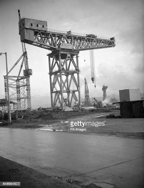 A 200ton cantilever crane at a Belfast wharf Built by a Glasgow firm it stands 167feet above the quay and has been constructed to allow vehicles to...