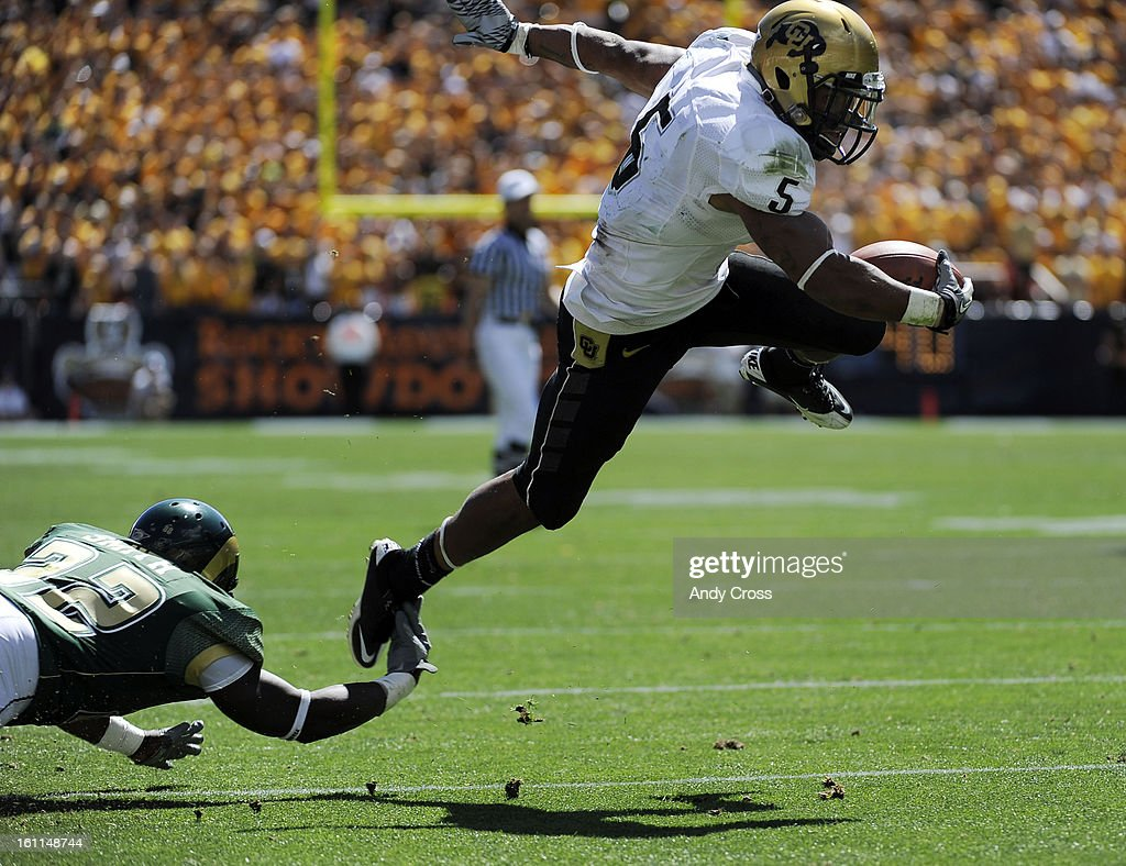 denver co th colorado university tb rodney denver co 4th 2010 colorado university tb rodney stewart right gets airborne close to the end zone against colorado state db