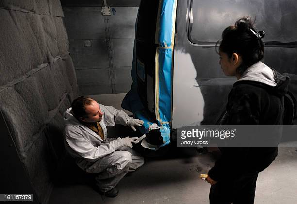 COFEBRUARY 19TH 2010Jamie Powell left center director for Maaco Auto Body shop at 4910 Oneida St in Denver works with Marilo Salazar preparing a van...