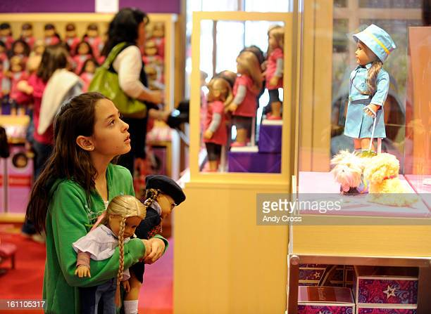 COMARCH 26TH 2010Jazmyn Andre 10yesarsold from Parker looks at an American Girl doll in a glass case holding two American Girl dolls one that she...