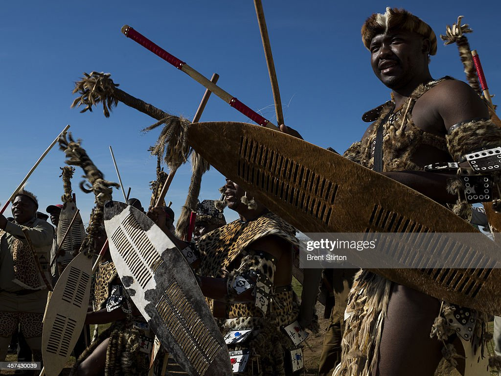 Traditionally dressed warrior dancers prepare to board buses to dance for the Nelson Mandela funeral dignitaries, Qunu, South Africa, 14 December 2014. An icon of democracy, Mandela was buried at his family home in Qunu after passing away on the 5th December 2013.