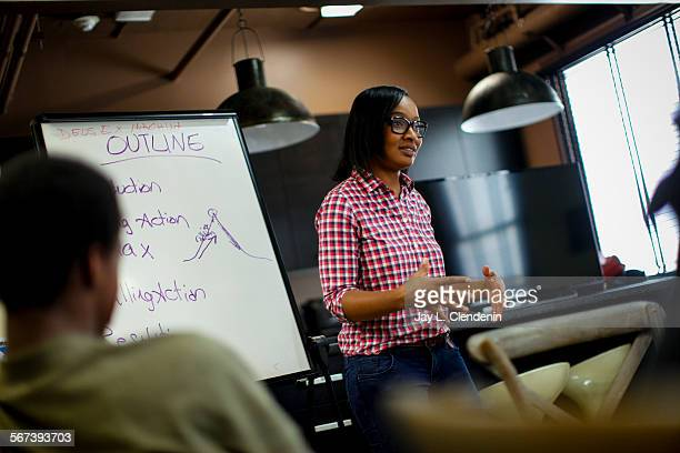 LOS ANGELES CA JUNE 19 2014Alvy Johnson program coordinator and lead instructor at Ghetto Film School LA talks to students about writing their...
