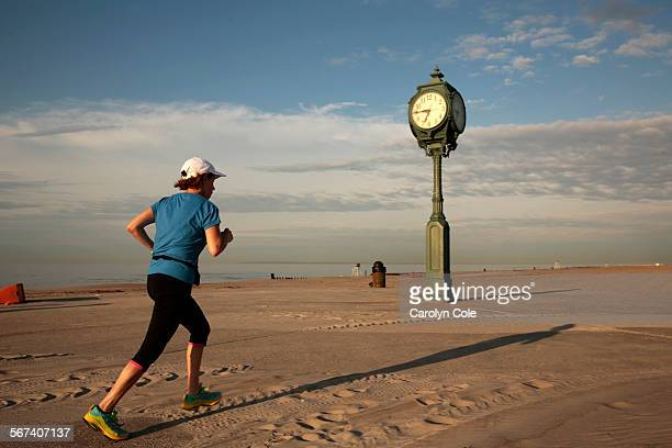 YORKMAY 21 2014At Gateway National Recreation Area known as Jacob Riis Park a woman runs along the path still covered in sand Preparations are still...