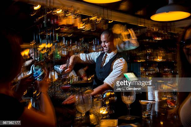 CITY CA OCTOBER 16 2014Head mixologist Russell Thomas pours a 'Betty Boop' with vodka muddle blackberries elderflower liqueur and lemon for $12 at...