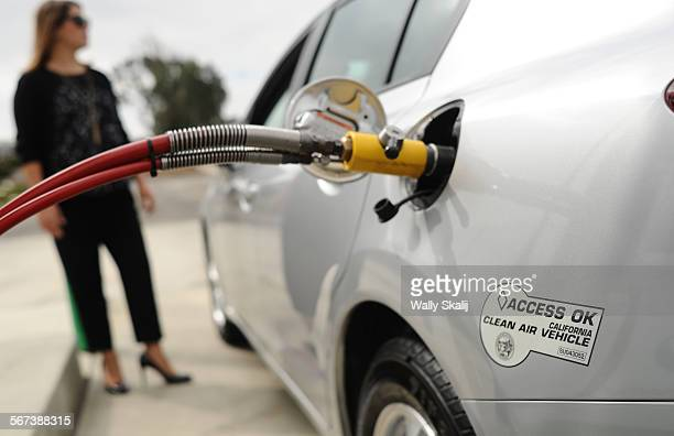 Honda employee Angie Nucci demonstrates how to fill a Honda Civic with Natural Gas at a CNG station in Torrance