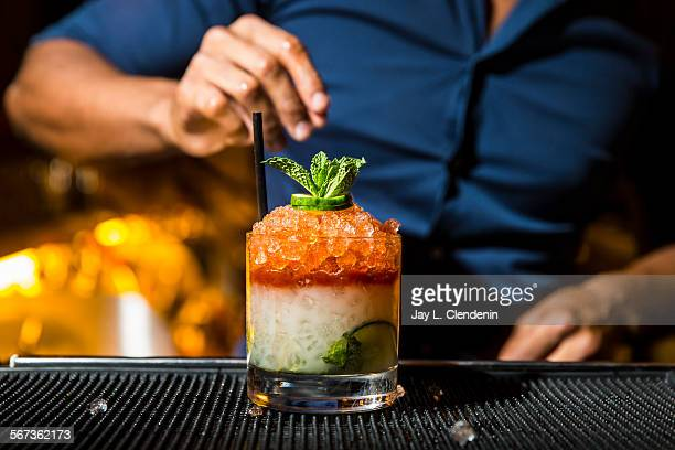 MONICA CA OCTOBER 16 2014The 'West Side' with muddled cucumber and mint orgeat syrup fresh lime and vodka served on crushed ice with Angustura...