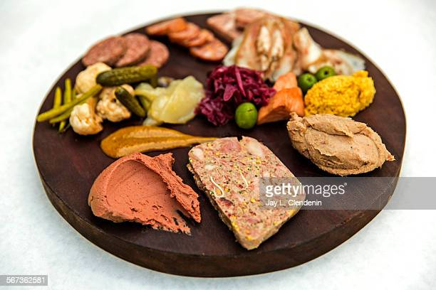LOS ANGELES CA FEBRUARY 12 2015Assiette de charcuteries with a sampling of from front left truffled chicken liver terrine de campaign rillettes...