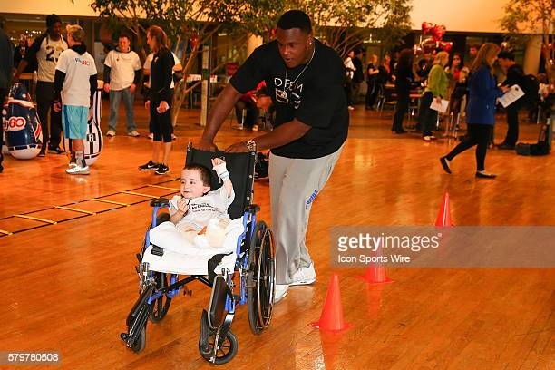Florida Offensive Tackle DJ Humphries pushes Matthew Hipskind through the cones at the Shriners Childrens Hospital in Chicago The event brought 19...