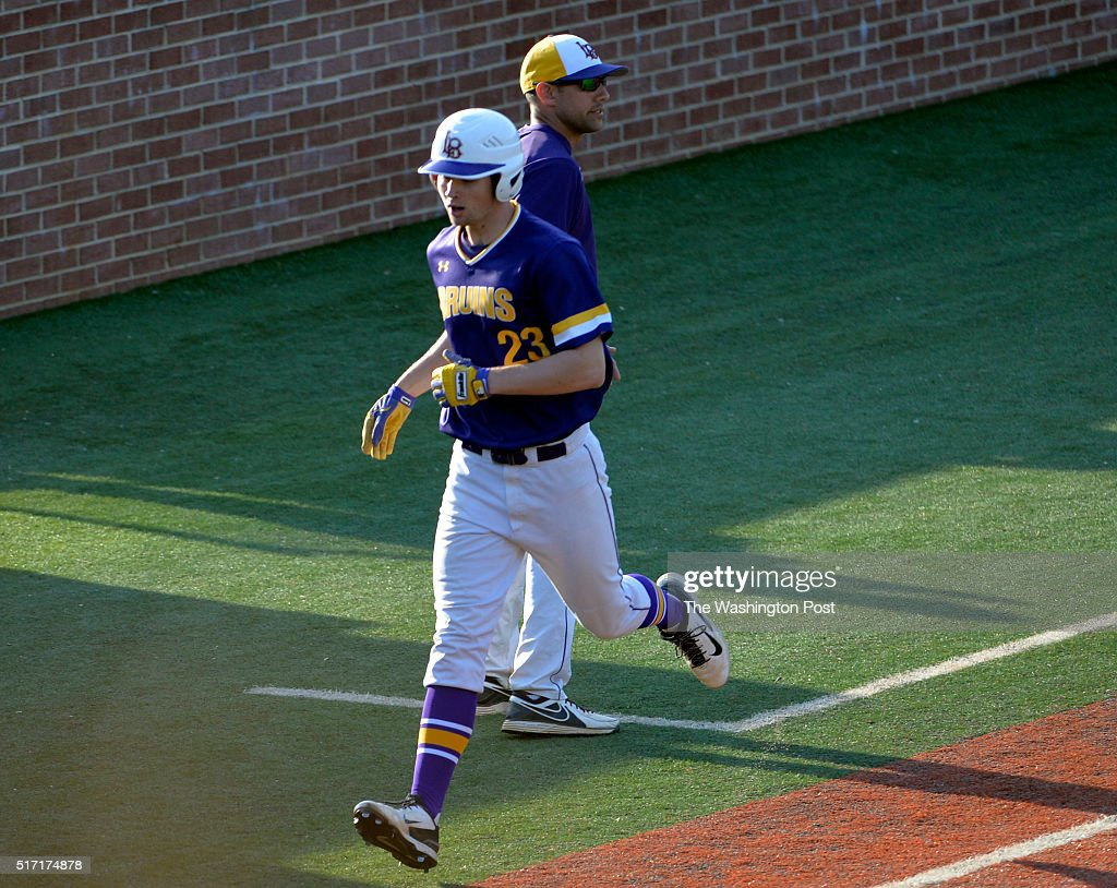 Lake Braddock's Ethan Rolland (23) rounds third base on his way to home plate after the grand slam homer against St. John's on March 23, 2016 in Washington, DC.