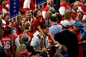 On Tuesday the second day of the Republican National Convention a young attendee rides on the shoulders of another