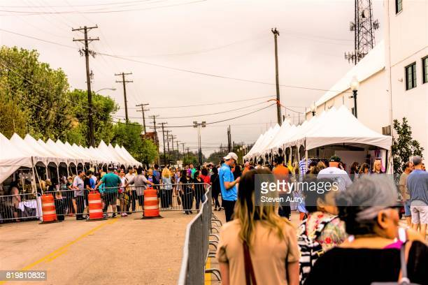 WACO, TX, USA  MARCH 18, 2017:Large group visiting vendor's tents outside of Magnolia Market.