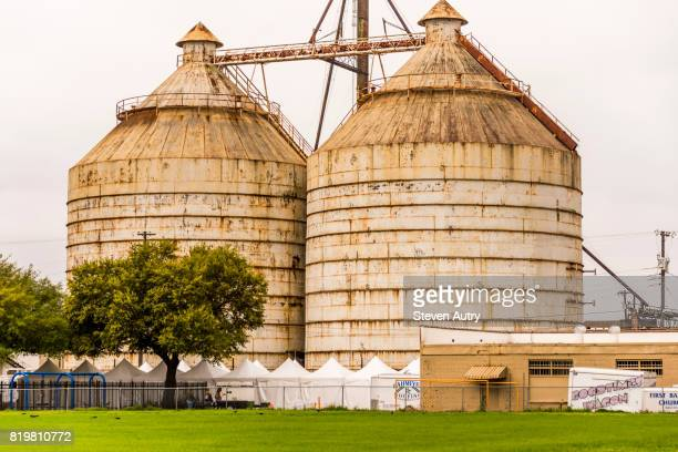 WACO, TX, USA  MARCH 18, 2017:Magnolia Silos and arts and crafts tents from a field behind the Silos..
