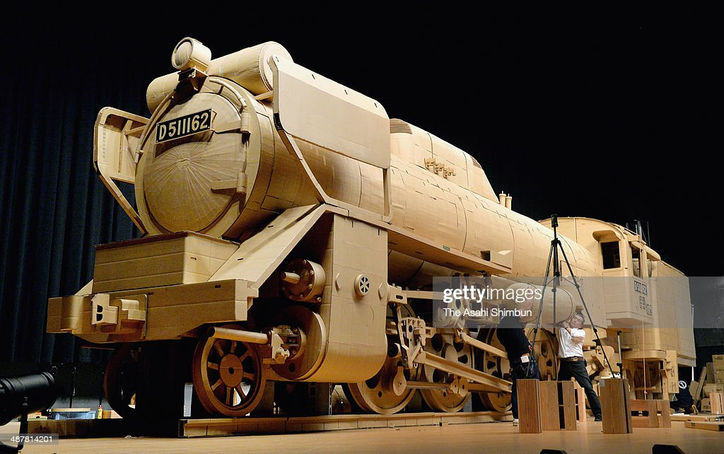 A 20-meter-long real size cardboard-made model of steam locomotive 'D51' is seen on May 2, 2014 in Higashisonogi, Nagasaki, Japan. The model, made by 4,000 cardboard boxes without using screws, weighs 1.8 tons, will be displayed at the city's cultural hall until May 11.