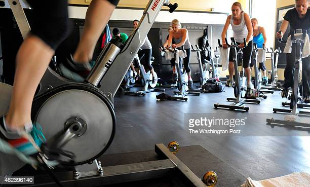 Spin class instructor Gabriella Boston riding with her class at the Capitol Hill Results Gym on April 20 2012 in Washington DC The class is made up...