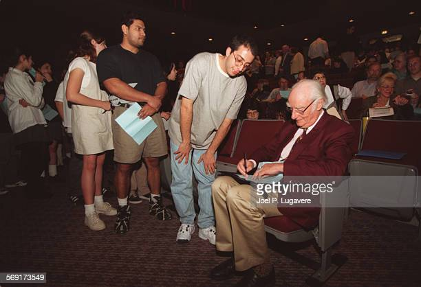 JPL NORTHRIDGE FEB 20Students Kelaidin Ebrahimi age 24 stands in line to have Dr Francis Crick sign the program for his speech at CSUN Thursday...