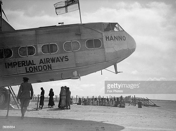 Hanno a Hannibal class aircraft of the Imperial Airways fleet refuels at Port Sharjah in the Persian Gulf en route to India guarded by the armed...
