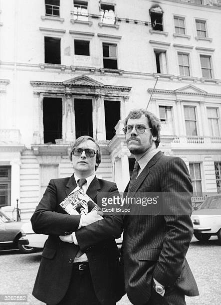 The former hostages and authors of the book titled 'Hostage' Sim Harris and Chris Cramer in front of the burnt out Iranian Embassy London