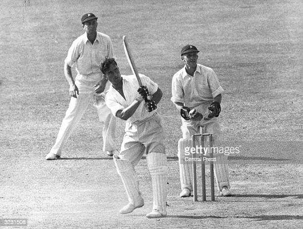 England batsman Denis Compton puts the ball out to the boundary during a quick century against the South Africans at the Oval London George Fullerton...