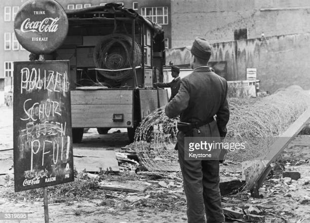 Police in West Berlin installing barbed wire fortifications at the Berlin Wall to protect it against demonstators in West Berlin The makeshift sign...