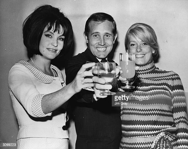 Stars of Roman Polanski's film 'Repulsion' Yvonne Furneaux Ian Hendry and Catherine Deneuve at a preshooting party at Twickenham Studios Middlesex
