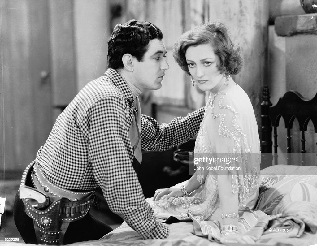 Johnny Mack Brown (1904 - 1974) tries to comfort Joan Crawford (1908 - 1977) in a scene from 'Montana Moon', directed by Malcolm St Clair.