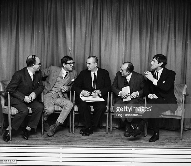 From left to right film directors Frank Launder John Boulting David Kingsley Sidney Gilliat and Roy Boulting at a meeting