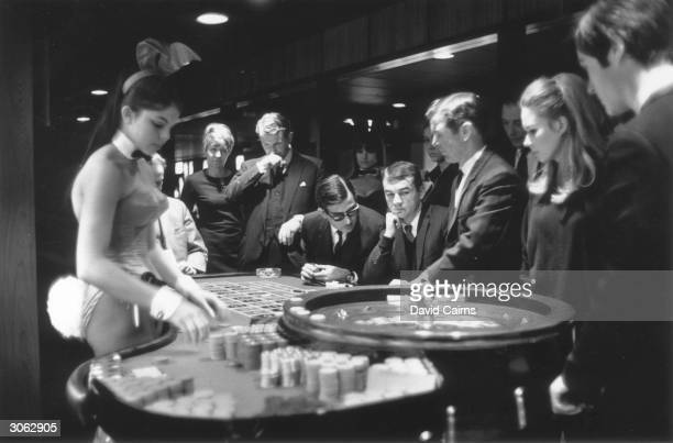 Young hopefuls place their bets at London's Playboy Club on Park Lane Central London