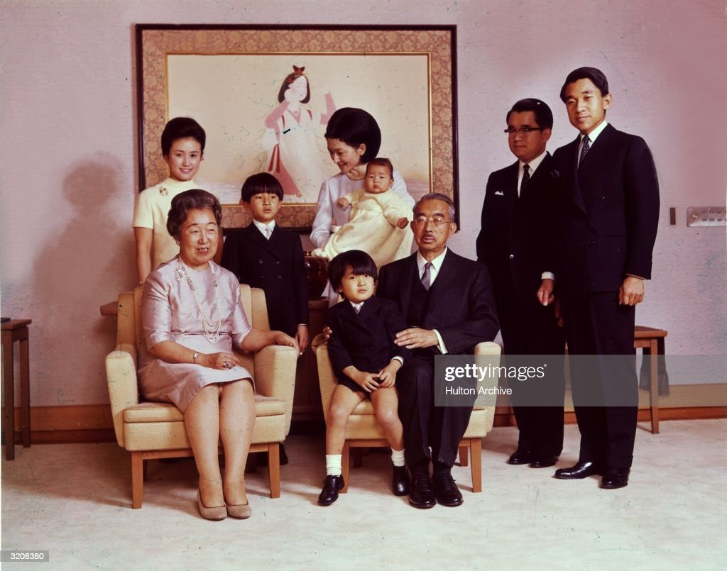 Portrait of Emperor Hirohito (1901 - 1989) and Empress Nagako posing with their children and grandchildren. L-R: Crown Prince Akihito, Prince Hitachi, Emperor Hirohito, seated with Prince Aya (Akishino) on his lap, Crown Princess Michiko, holding her daughter, Princess Nori, Prince Hiro, the eldest grandchild and heir to the throne, Empress Nagako and Princess Hanako.