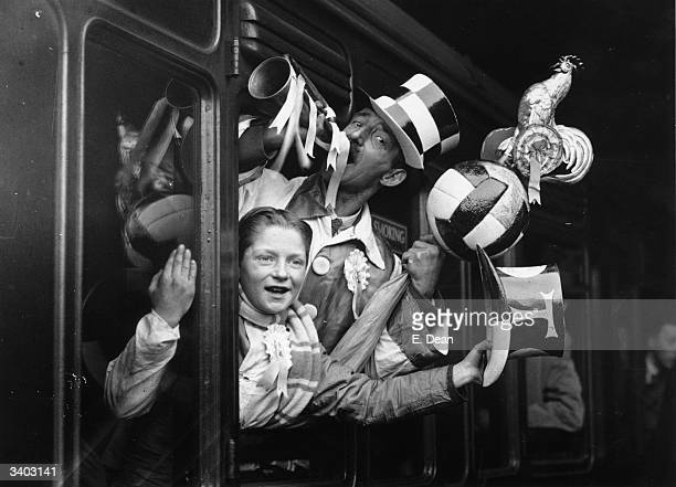 Tottenham Hotspur Football Club supporters depart in high spirits from London's Euston Station bound for Cheshire where their team play New Brighton...