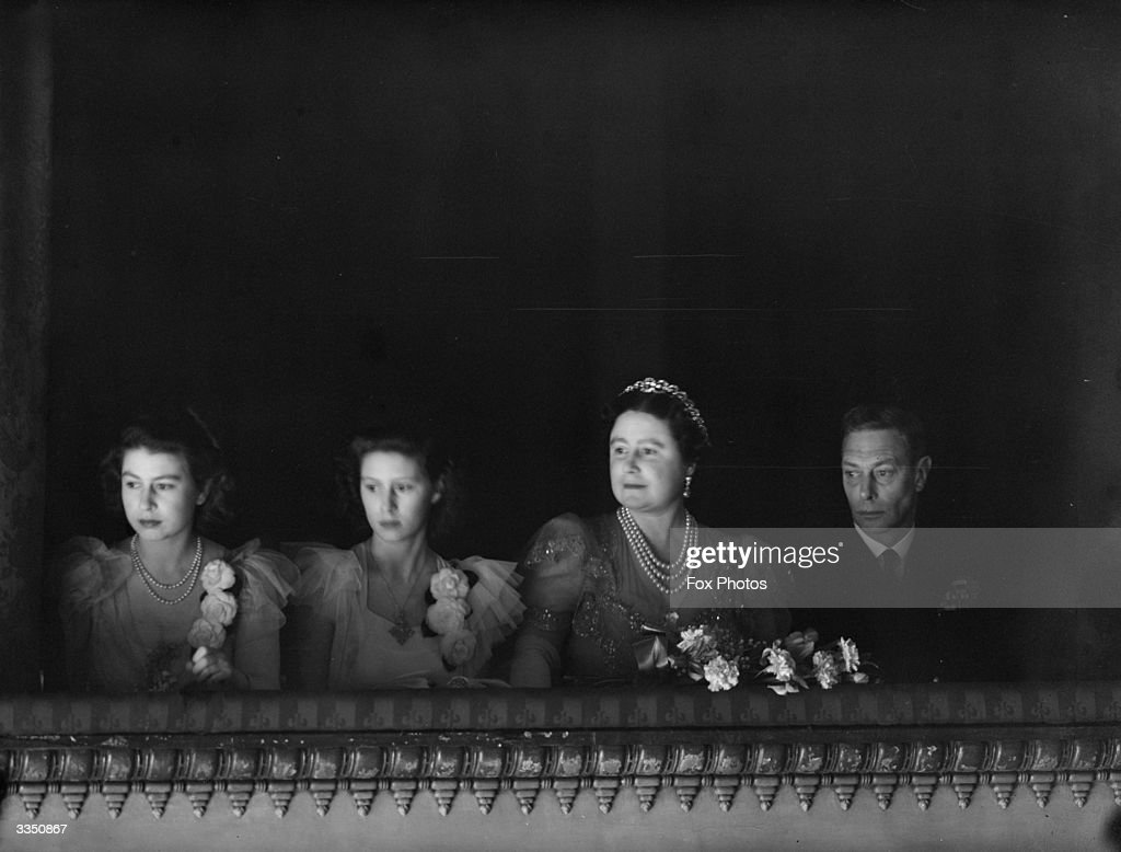 King George VI and Queen Elizabeth (1900 - 2002), accompanied by the two Princesses, in the royal box for the re-opening of the Royal Opera House, Covent Garden, London. They are watching a performance of Sleeping Beauty by the Sadler's Wells Ballet company.