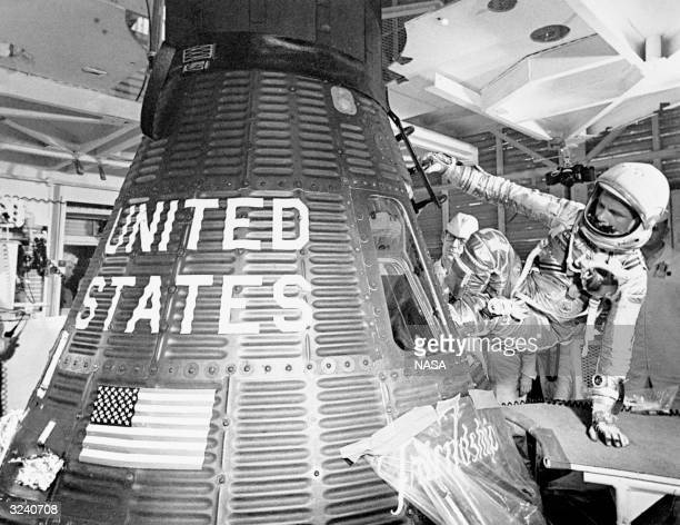 Astronaut John Glenn boards the Friendship 7 capsule to become the first American to orbit the earth during the MA6 mission