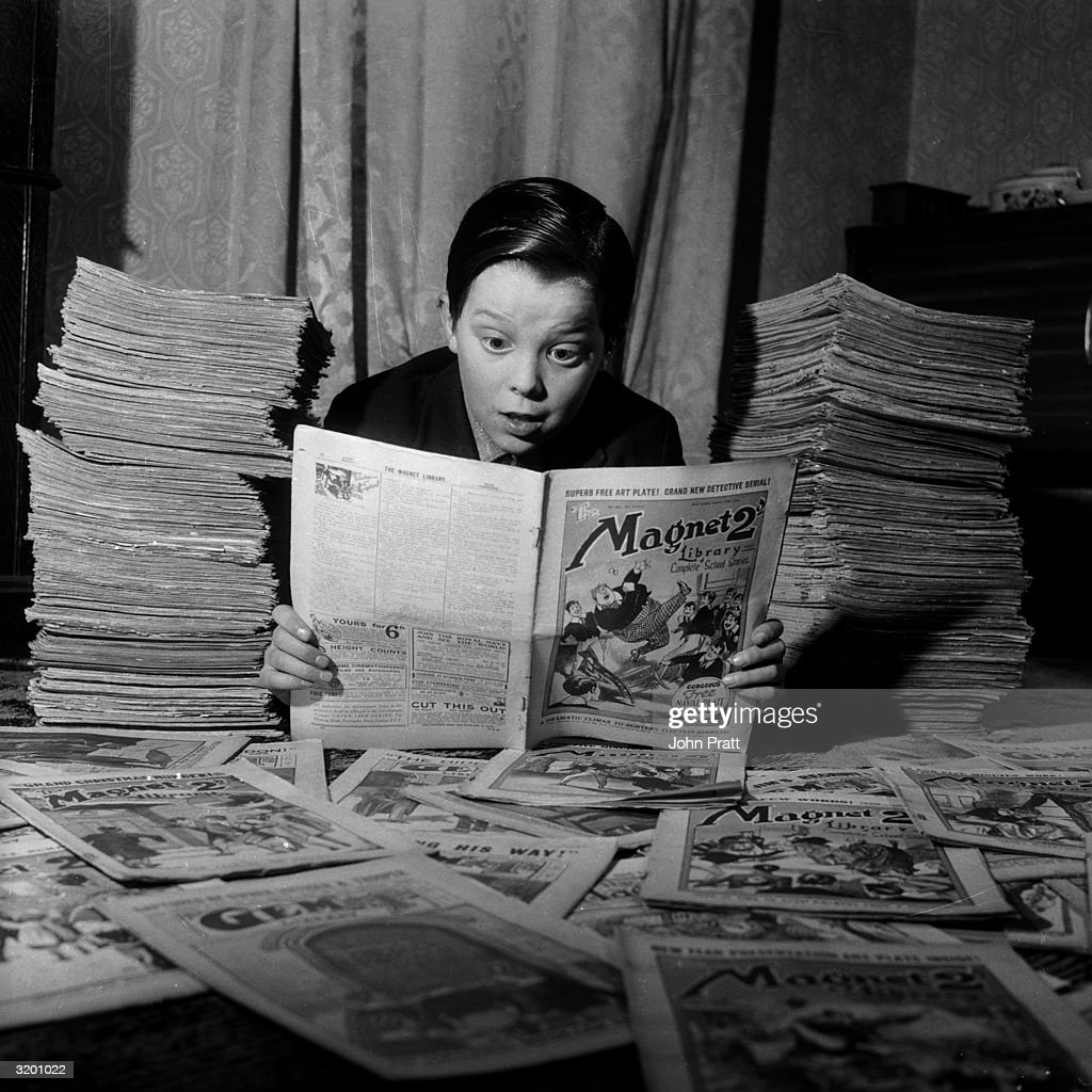 Thirteen year-old Michael Harris avidly reads one of the thousands of vintage comics in the collection of his neighbour, Leonard Packham of Dulwich. Packham, a 57 year-old civil servant, is one of the founder members of the Old Boys' Book Club - a group which buys and swaps children's comics of the 1920's and 30's.