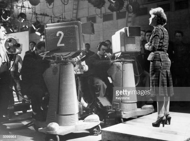 Popular singer Edith Piaf being filmed for a French ABC television broadcast after a tour of the USA