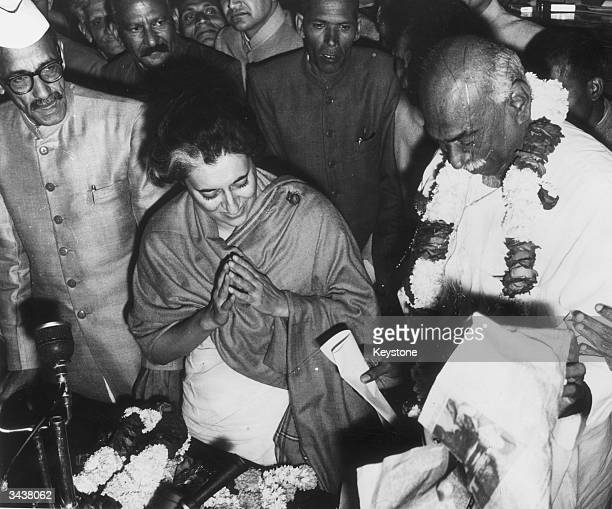 Mrs Indira Gandhi with Mr Kamaraj and Mr Nanda makes a gesture of peace after her election as leader of the Congress Party