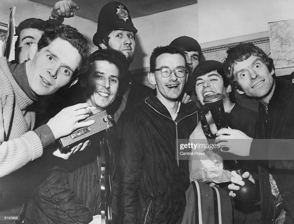 The disc jockeys of seagoing pirate radio station, Radio Caroline at Walton police station in Essex after their ship ran aground in bad weather. The DJ's, including <a gi-track='captionPersonalityLinkClicked' href=/galleries/search?phrase=Dave+Lee+Travis&family=editorial&specificpeople=1624287 ng-click='$event.stopPropagation()'>Dave Lee Travis</a> (in hat) and Tony Blackburn (second from right), had to be rescued by breechers buoy.