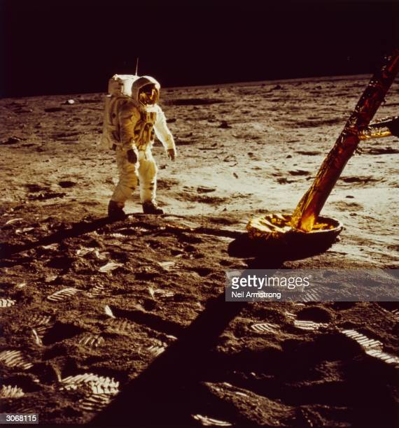 American astronaut Edwin 'Buzz' Aldrin Jnr walks on the surface of the moon during the Apollo 11 mission His footprints are scattered around the leg...