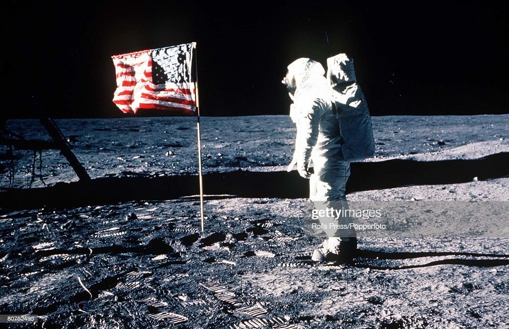20th JULY 1969 Apollo 11 Space Mission Ed 'Buzz' Aldrin salutes the American flag on the surface of the moon during the Moon Landing