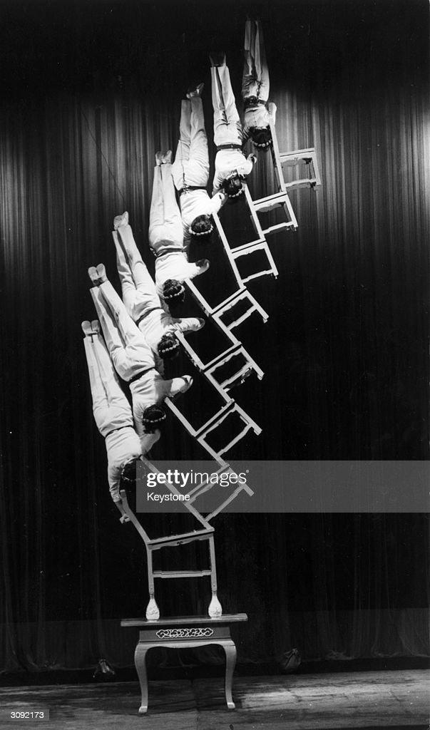 Chinese acrobats from Chungking performing their amazing chair balancing act at the Dominion Theatre in London.