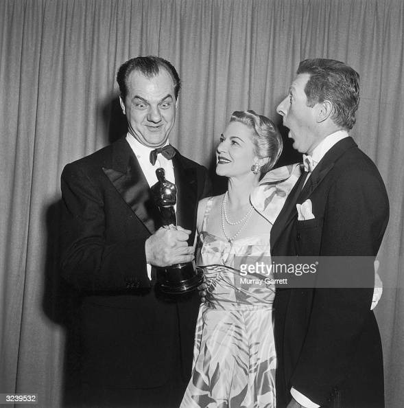 EXCLUSIVE LR American actors Karl Malden Claire Trevor and Danny Kaye make faces at Malden Best Supporting Actor Oscar statue backstage at the...