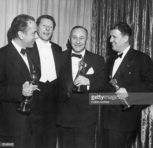 Left to right actors Humphrey Bogart and Danny Kaye producer Arthur Freed and director George Stevens pose with their Oscar trophies at the Academy...