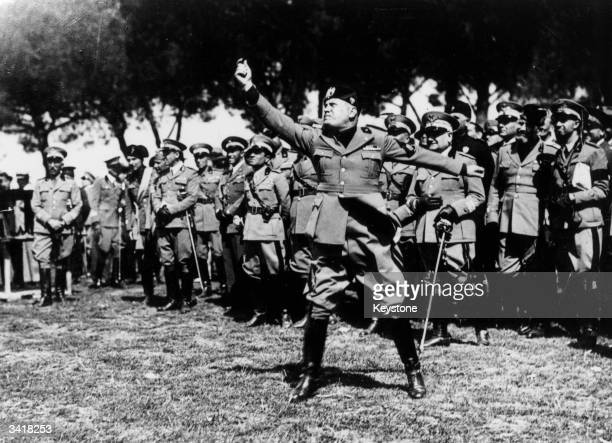 Italian dictator Benito Mussolini testing a new type of gas bomb during a demonstration in Rome of various chemical weapons