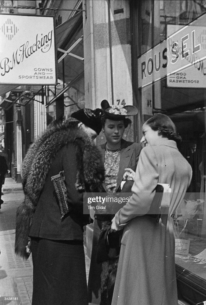 Three smart ladies shopping in Bond Street an upmarket shopping district of London Original Publication Picture Post 67 Bond Street pub 1939